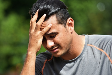 Worried Adult Male Athlete Stock Photo