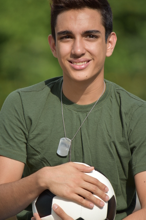Happy Athletic Hispanic Male Teen Soldier