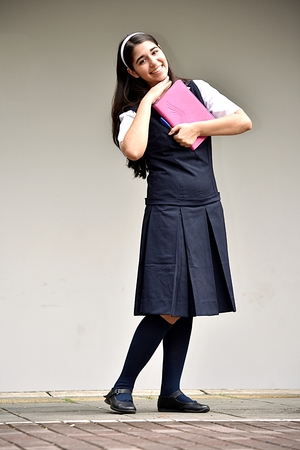 Adorable Female Student Wearing School Uniform With Notebook