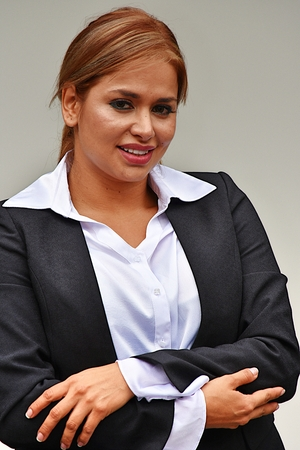 Smiling Latino Business Woman Wearing Suit Stock Photo
