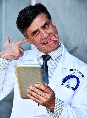 Insane Male Doctor With Tablet