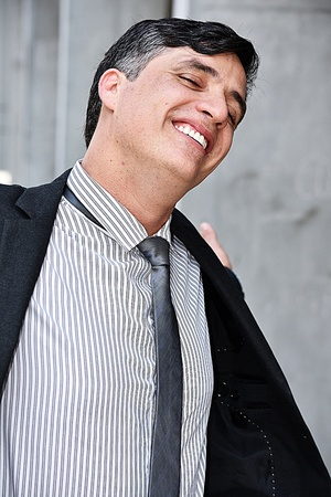 Confident Latino Entrepreneur Wearing Suit And Tie Stock Photo