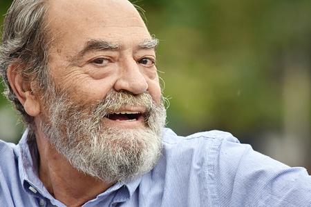 Bearded Old Male Talking Stockfoto