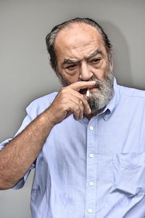 Smoking Senior Male Stock Photo