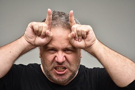 Sinister Unshaven Adult Male Foto de archivo