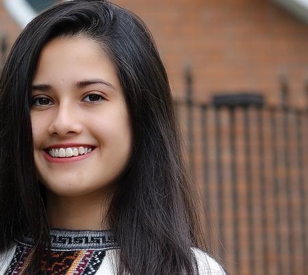 A Hispanic beautiful smiling young girl