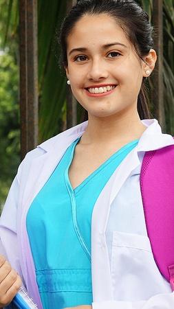A smiling female nursing student