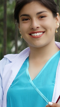 A smiling female nursing student