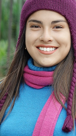 Smiling Female Teen Blue Sweater And Scarf