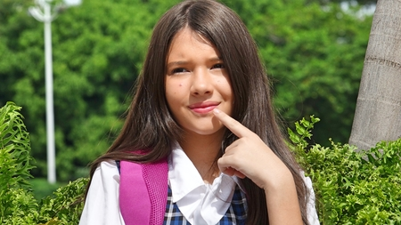 Young Female Student Thinking Stock Photo