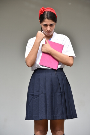 Mad Female Student Wearing School Uniform With Notebook