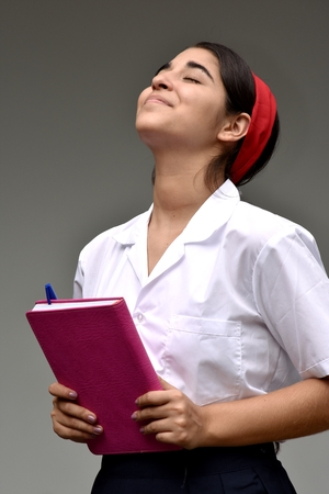 Daydreaming Catholic Female Student Wearing School Uniform Stock Photo
