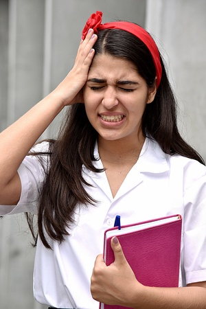 Cute Colombian Female Student And Anxiety With Notebook