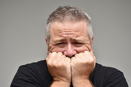 Fearful Overweight Man Stock Photo - 100133187