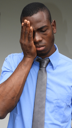 Unhappy Black Person Stock Photo