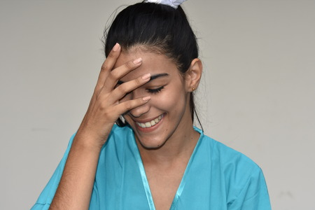 Young Female Nurse And Shyness Stock Photo