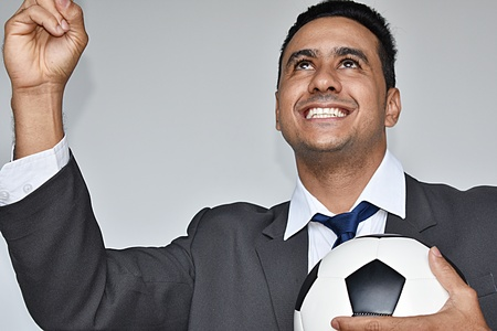 Male Sports Manager And Soccer Victory Stock Photo