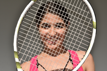Female Teen Tennis Player With Racket