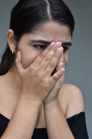Ashamed Minority Teen Girl