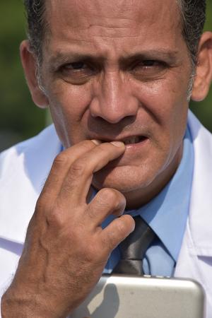 Worried Minority Male Surgeon Stockfoto