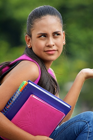Beautiful Teen Female Student And Confusion