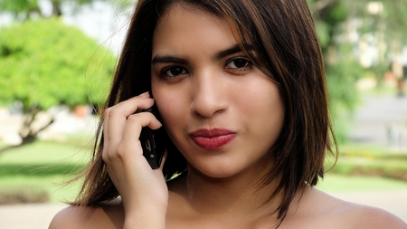 Pretty Female Using Cell Phone Stock Photo