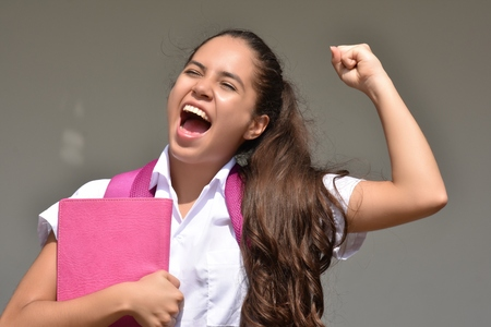 Excited Female Student Wearing School Uniform