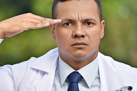 Male Civilian Doctor Saluting Stockfoto - 101930819
