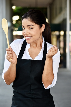 Cute Smiling Adult Female Chef Stock Photo