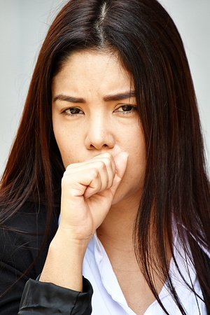 Diverse Business Woman Coughing Wearing Suit