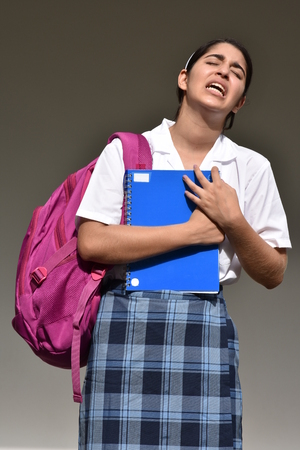 Confused Female Student Wearing School Uniform Stock Photo