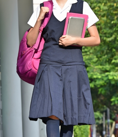 Female Student With Uniform Walking To School