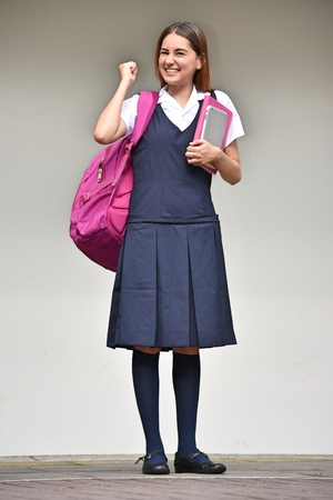 Excited Student Teenager School Girl Wearing Skirt While Standing