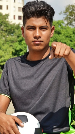 Athletic Male Soccer Player Pointing