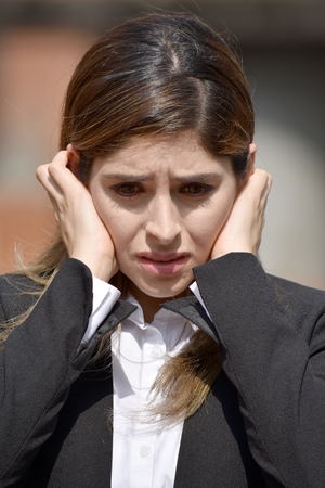 Stressed Adult Colombian Business Woman Wearing Suit
