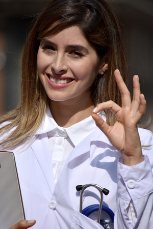 Cute Female Doctor And Okay Sign Stock Photo