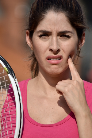 Female Tennis Player With Toothache Wearing Sportswear