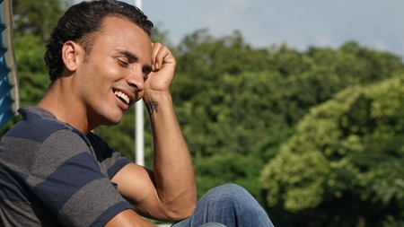 Young Colombian Male Daydreaming Stock Photo