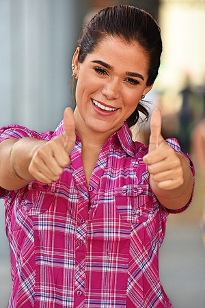 Hispanic Adult Female With Thumbs Up Wearing Pink Shirt