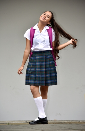 Girl Student With Long Hair Wearing School Uniform Stock Photo