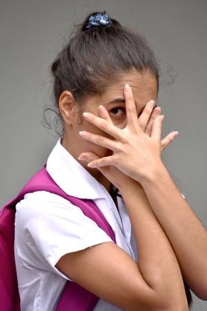 Ashamed Colombian Female Student Wearing School Uniform Stock Photo
