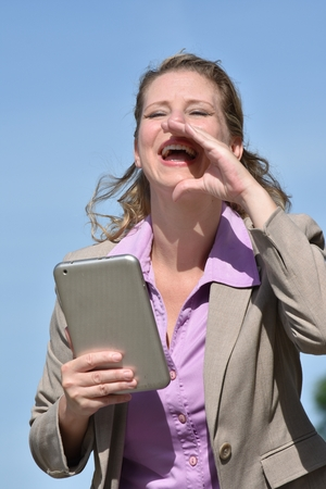 Adult Blonde Business Woman Yelling With Tablet