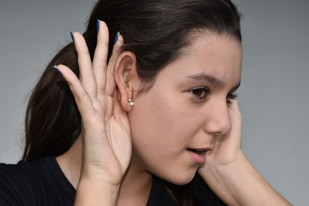 Listening Latina Female Youngster