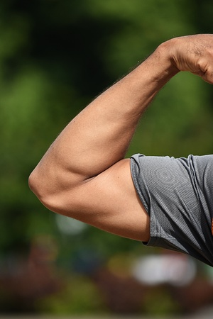 Man Flexing Muscular Bicep Muscles