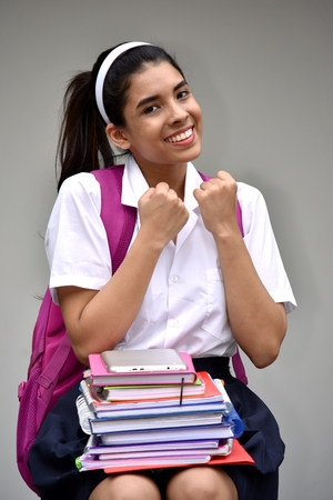 Cute Colombian Female Student And Muscles With Textbooks Stock Photo