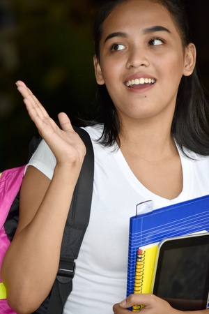 Surprised Female Student With Books