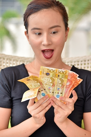 Filipina Woman Counting Money