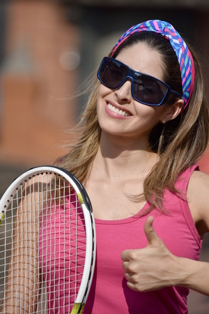 Athlete Colombian Female Tennis Player And Happiness Wearing Sportswear With Tennis Racket
