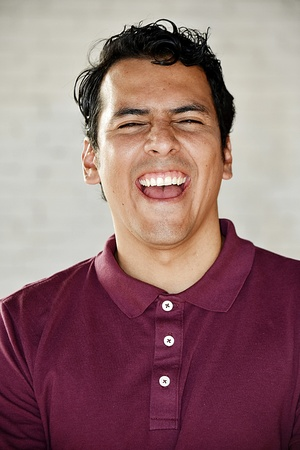 Minority Male And Laughter Stock Photo