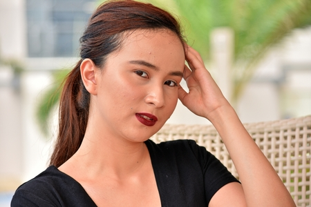 Unemotional Asian Person Stock Photo
